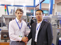 www.RomanTsibulsky.com a Roman Tsibulsky with the Chinese partners at an exhibition of the pharmaceutical equipment, 2012, the city of Shenyang, China.
