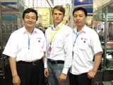 Roman Tsibulsky with partners at an annual international pharmaceutical machine-building exhibition, in 2009 in the city of Zhengzhou China.